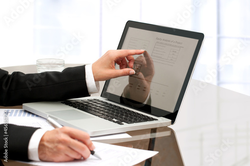 Female business hands working on table.