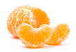 Peeled slices of tangerine on white