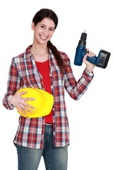 Female handywoman with drill