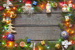 Christmas background border with baubles and lights