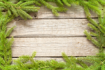 Christmas background border with fir on wooden boards