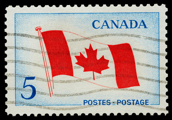 Mail stamp featuring the Canadian national flag, circa 1965