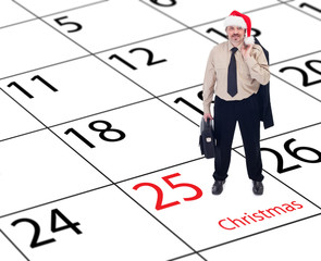 It's finally christmas - businessman standing on calendar