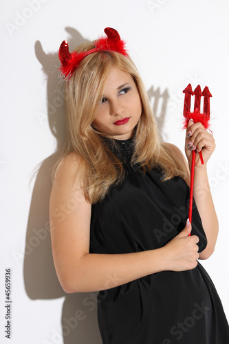 Blonde girl wearing a costume of an imp
