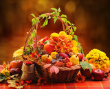 Fototapety Wicker basket with autumn fruits and flowers