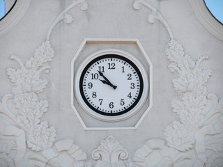 clock on a wall of airport in Kharkiv