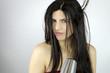 Beautiful woman drying long hair