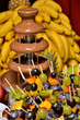 Dipping fruits into a Chocolate Fountain