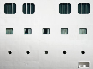 Background texture photo of white ships hull with windows
