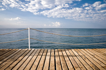 Wooden pier with railings. Mediterranean sea, Alanya, Turkey
