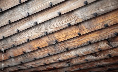 Leinwanddruck Bild Old wooden ship hull texture