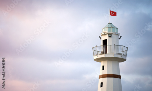 Upper part of white Lighthouse with Turkish flag