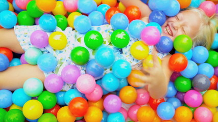 Cute Blonde Child Enjoying Ball Pool
