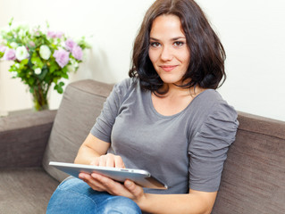 Smiling woman and touchpad