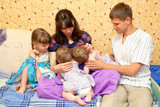 Breast feeding two little sisters twin girls at same time