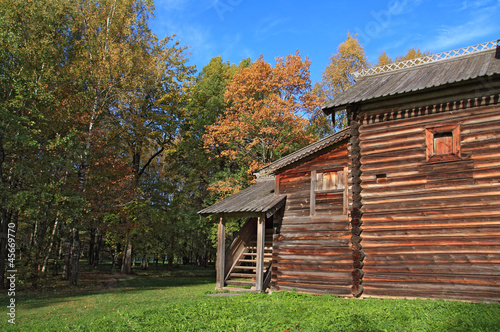 rural wooden house amongst autumn wood