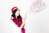 Beautiful girl in santa hat with  christmas-tree