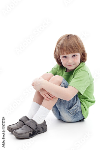 Small boy sitting