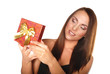 Happy beautiful woman with present box