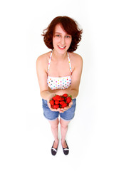 Smiling young woman with strawberries isolated on white backgrou
