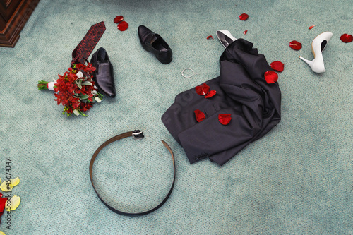 disrobed wedding clothes. straggle objects. Shues, suit, bouquet