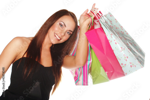 Happy woman with bags and gifts