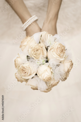 beauty wedding bouquet of roses in a bride hands