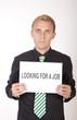Young attractive man with a sign looking for a job