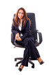 Young business woman sitting on a chair isolated on white