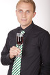Young attractive businessman with a glass of wine