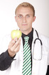 Young attractive male doctor with apple