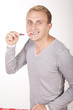 Young attractive man with toothbrush