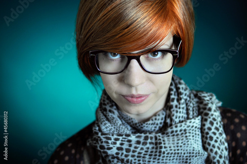 Girl with red hair and glasses
