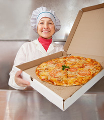 female cook with  pizza