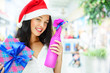 Portrait of young pretty woman wearing Santa Claus helper hat st