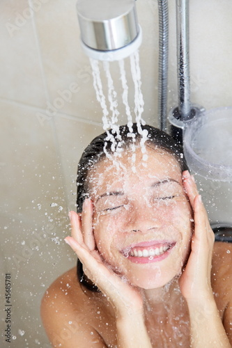 Shower woman washing face
