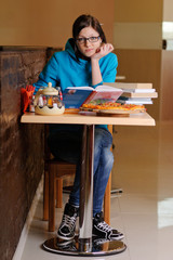 Beautiful college student in pizzeria. Indoor shot