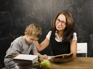 teacher with pupil at blackboard