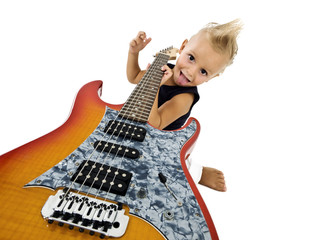Happy kid with electric guitar