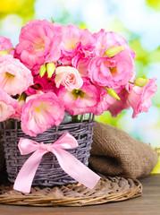 bouquet of eustoma flowers in  wicker vase,