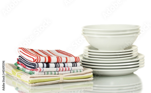 Kitchen towels with dishes isolated on white background