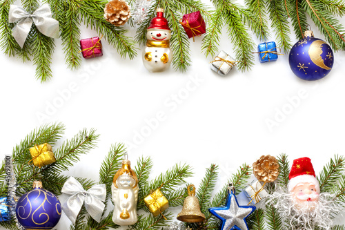 Christmas background border with fir and baubles on white