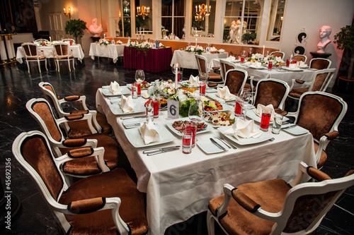 Luxury banquet table setting at restaurant - 45692356