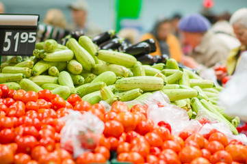Tomatoes, zucchini and eggplants in supermarket