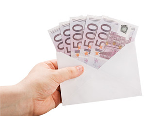 hand holding an envelope with money isolated on a white backgrou