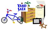 Sign on a lawn with items for sale at their yard sale
