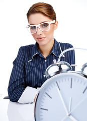 young attractive woman with big clock on white.