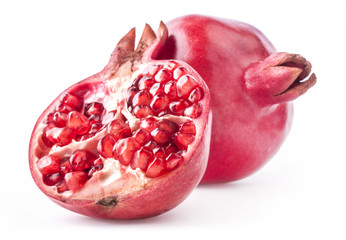 Red pomegranate fruits isolated on white background