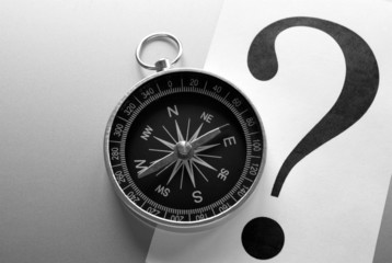 compass and question mark on a gray gradient background