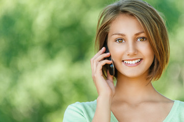 smiling beautiful young woman with phone
